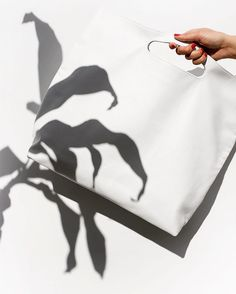 Shadow play: one KMart mirror reflector with a beat-up poster board on a 3ft wide balcony, someone perfectly tilts a Dr. Seuss plant and another strains her arm holding the bag too far away while both try to keep their bodies and shadows out of frame. And we were all sweating. ... Simple, really. /// #fashion #chic