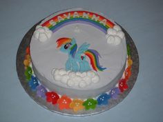 Rainbow Dash cake for little girl that loves My Little Ponies.  Cake was rainbow checkerboard inside too.