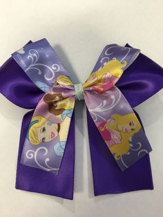 A personal favorite from my Etsy shop https://www.etsy.com/listing/224668230/purple-satin-hair-bow-with-disney