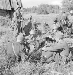 Finnish soldiers resting in a captured Russian village. Jalonvaara, Soanlahti…