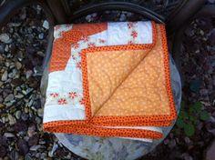 Orange baby quilt or blanket. $105.00, via Etsy.