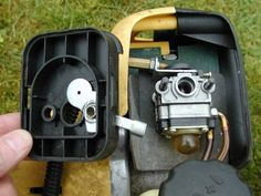 The carburetor exposed - Next the fuel lines and throttle cable must be removed Chainsaw Repair, Go Kart Plans, Lawn Mower Repair, Tractor Mower, Lawn Tractors, Garage Furniture, Yard Tools, Engine Repair, Small Engine