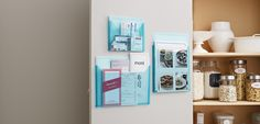 Store coupons, recipe cards, and menus in adhesive pantry pockets.