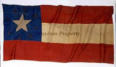 """First National Flag of the 25th Virginia Infantry (tentative) captured at the  Battle of Phillipi, Virginia, June 3rd 1861 by Lieut Wm. B. McCartney, Co. B, 16th Regiment Ohio Volunteers""""  The inscription around the stars in the canton is """"Virginia,"""" in gold paint. The American Civil War Museum."""