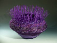 Emily Dvorin is a self-defined sculptural basketmaker. She works in vessel format but uses recycled, upcycled materials that are commonly thought of as commercial products, including but not limite…
