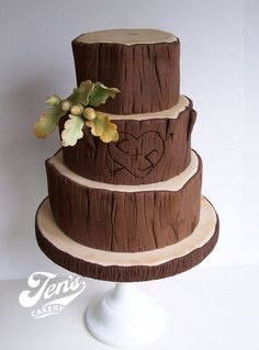 Tree carving wedding cake, change out acorns to burlap and lace or wedding colors.