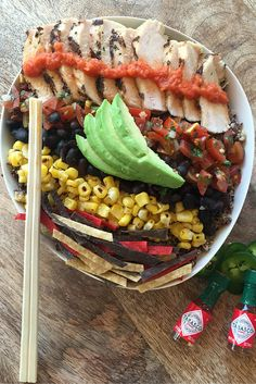 Spicy foods are great for boosting metabolisms! Try this delicious combination of grilled chicken, avocado, black beans, grilled corn and thinly sliced gluten free tortilla chips for your next lunch prep! Bowl provided by The Storied Table.