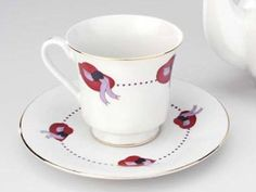 Set of 6 Red Hat Tea Cups & Saucers have wide-brimmed red hats with lavender ribbon circle. New inexpensive Red Hat tea cup and saucer sets. Gold edging on both teacup and saucer adds incredible elega