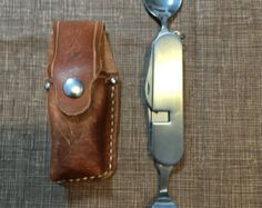 Custom Handmade Leather Sheath with the Pocket Knife by dmbrohm