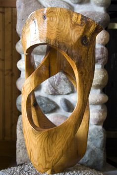 Red oak ribbon abstract wood sculpture by Sam Soet.