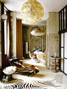 Mixing many cultures, antique and mid century modern furnishing by Carlo Mollino
