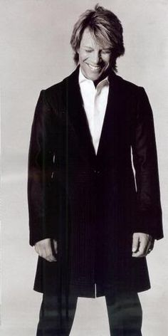 Jon Bon Jovi .....help, I need a fan.  Those crisp white shirts and long black trench coats get me every time ♥♥♥