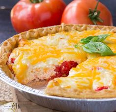 Traditional Southern Tomato Pie is full of juicy sweet tomatoes, gooey cheese and sits in a buttery crust!