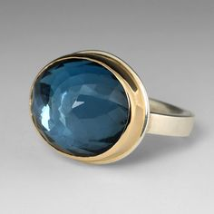 London blue topaz is a QUADRUM favorite for it's deep, cool blue color.  An absolute must-have Jamie Joseph
