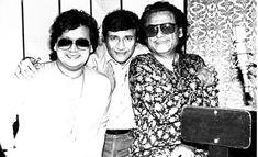 With Bappi Lahiri and Dev Anand.