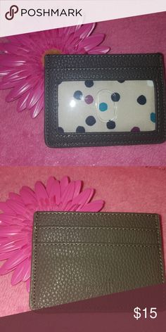 """Extra Credit wallet city charcoal pebble The slim and simply chic Extra Credit Wallet is an easy way to carry just the essentials, including your credit cards, cash and ID, wherever you go. Features an ID holder, two credit card slots and a middle opening for cash.  Faux leather 2 credit card slots, 1 middle opening an ID window Approx. 3""""H x 4""""L Storage item#:A1 Thirty-One Bags Wallets"""
