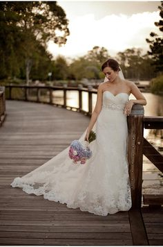 Wedding photo classic demure bride with dress and bouquet