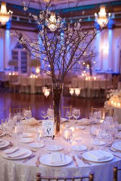 Perfect And Romantic Winter Wedding Branch Centerpiece Vanchitecture wedding centerpieces Wedding Reception Centerpieces, Wedding Flower Arrangements, Flower Centerpieces, Wedding Decorations, Centerpiece Ideas, Willow Branch Centerpiece, Rustic Centerpiece Wedding, Uplighting Wedding, Winter Centerpieces