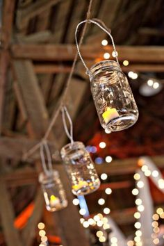 "I was watching ""Mama Mia"" this afternoon when I noticed the actors hanging up jar-lanterns for the wedding. What a lovely idea! This goes along great with my jar centerpiece idea and is (once again) very easy to put together. Ask around to see who has canning jars hiding in their basement that you can borrow and check out sites like Oriental Trading for affordable tea candles."