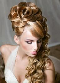 Another beautiful floral hairstyle! In this hair style, you see the same flower in the hair in this pic that you see in a picture I posted just recently. But, in this style, elegant curls come down the side of the model's neck.