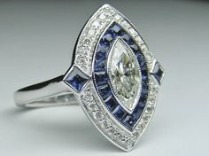 Marquise Diamond Art Deco Engagement ring with Blue Sapphire & Diamond Halo in White gold