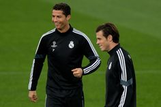 Cristiano Ronaldo (L) of Real Madrid CF laughs close to his teammate Gareth Bale during the training session ahead of the UEFA Champions League Group B match between Real Madrid CF and Liverpool FC at Valdebebas training ground on November 3, 2014 in Madrid, Spain.