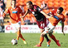 Norwich City's Gary O'Neil is tackled by Blackpool's Sergei Zenjov