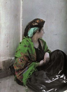 A Moroccan Jew in traditional clothing sits against a wall, Morocco, 1925 (autochrome) by Gervais Courtellemont / National Geographic Image Collection