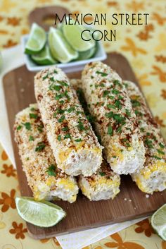 Piping hot corn on the cob is smeared with mayonnaise and dredged with Queso or Cotija cheese, fresh cilantro, chile powder, lime and plenty of salt and pepper.