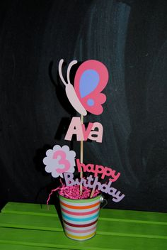 Butterfly Birthday Centerpiece With Childs Age And Name. $16.00, via Etsy.