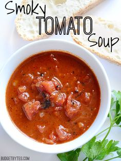 This rustic Smoky Tomato Soup has chunks of fire roasted tomatoes, smoked paprika, and earthy cumin. It's a fast and flavorful side to your weeknight meal. @budgetbytes