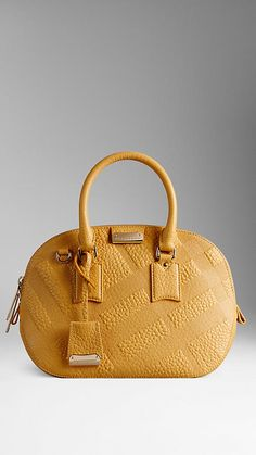 The Small Orchard In Saffron Yellow Embossed Check Leather from Burberry - Crafted from check-embossed signature grain leather, the bowling bag has a structured shape inspired by vintage luggage.  An artisanal design, it features rolled leather handles, a detachable shoulder strap and top zip closure.Discover the women's bags collection at Burberry.com