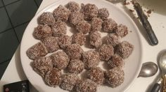 Energy!!!! May these delicious balls give me the energy I need to tackle everyday  <3 Recipe: -1 banana -2carrots -50g dry figs -200g dates -1 tsp barley malt -100g coconut flour (those small flakes) -carob flour  put all the ingredients in the mixer. then make balls with hands and cover with coconut. put in the fridge at least for one night. perhaps they will be a little bit soft...I accept suggestions