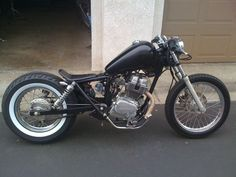 It doesn't look much like the original / Rebel bike. It makes me want to get some spoked wheels for my CB. Thats also some serious swingbar extension 2000 Rebel Bobber Honda Bobber, Honda Rebel Bobber, Sportster Motorcycle, Bobber Bikes, Bobber Chopper, Vintage Bikes, Vintage Motorcycles, Custom Motorcycles, Custom Bikes