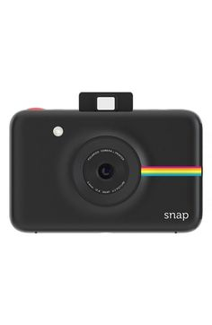 Snapping pictures with this slim little digital camera featuring an on-board printer to deliver instant results. This is the classic Polaroid picture experience with a modern twist.