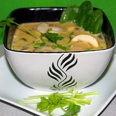 Thai Curry Soup Recipe Soups, Main Dishes with rice noodles, olive oil, garlic, lemon grass, ground ginger, red curry paste, chicken broth, soy sauce, white sugar, reduced fat coconut milk, medium shrimp, sliced mushrooms, baby spinach leaves, fresh lime juice, chopped cilantro, green onions