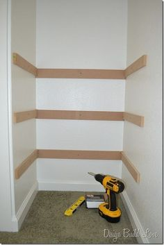 Third, I used my drill and screwed each support piece to the wall.  So, each shelf had three supports a piece.