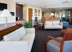 "The waiting and reception spaces at Reliant Medical Group's ReadyMED walk-in medical care clinics feature self-service check-in kiosks, wireless Internet, and interior finishes that give the space a ""living room"" quality. Photo credit: Warren Patterson Photography."