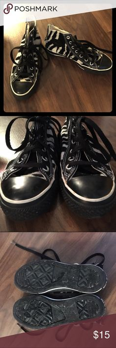 Rare zebra faux fur Converse Chuck Taylor sneakers Purchased in 2004 but rarely worn. Black & white faux fur upper with a zebra pattern. Black & white rubber soles. They're in great condition for their age but do have some wear & small orange marks where the glue has changed color over time. These aren't noticeable unless someone is inappropriately close to your feet. Insides have marks from price stickers but is otherwise perfect. They don't yet have the typical cracks but they're getting…