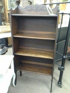 $139 - This it's a antique oak Larkin style folding bookcase. 4 shelves and they nicely detailed crown. The bookcase measures 25 and a half inches across the front, approximately 12 inches deep and it stands 52 in. to the tallest point. It can be seen in Booth D13 at Main Street Antique Mall 7260 East Main St ( E of Power Rd ) Mesa 85207  480 9241122open 7 days 10 till 530  Cash or charge 30 day layaway also available