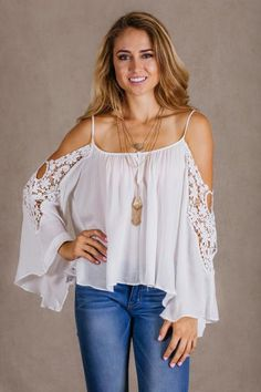 Beautiful lace, shoulder cut out blouse. Perfect for back to school and for the end of Summer!