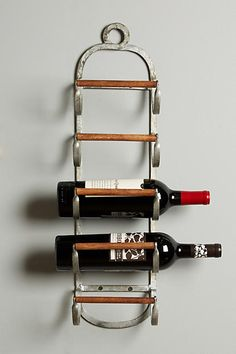 Decorate your wall with Anthropologie Tack Storage Wine Rack. Minimalistic and trendy.