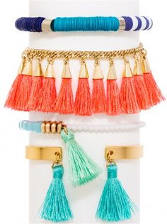 Get stacking: A rainbow of colors and tassels is ready for vacation. Cuff bracelet is not adjustable.