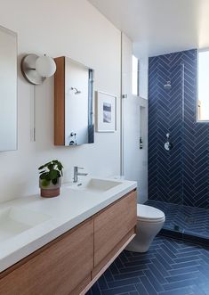 Contemporary Rustic Bathroom With Navy Blue Ceramic Tiles In Herringbone Pattern. Cool navy blue ceramic tiles in herringbone pattern on bathroom wall and floor for a contemporary rustic bathroom. Blue Bathroom Decor, White Bathroom, Bathroom Ideas, Bathroom Organization, Bathroom Colors, Bathroom Storage, Bathroom With Window, Shower Window, Restroom Ideas