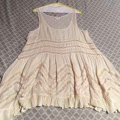 Free people intimates  authentic lace sun dress Maybe worn once it no longer fits me after surgery great condition just got them all dry cleaned. A cream white color with darker beige color polka dots.Open to offers always. You can tell condition of dress is perfect no stains rips or holes and it does fit like a small.  Free People Dresses