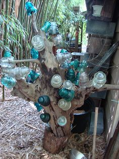 bottle tree from vintage insulators