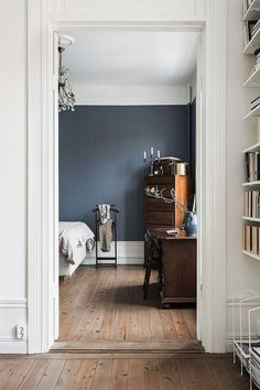Trend We're Loving: Deep Blues Dark Wood Rooms: scandinavian-inspired Blue Walls, Interior, Wood Room, Home, Brown Furniture, Dark Wood Bedroom, Dark Wood Furniture, Dark Brown Furniture, Scandinavian Interior