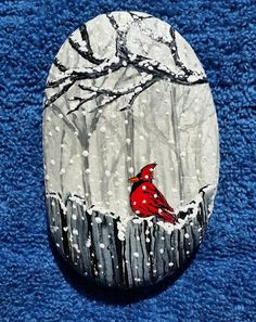 Cardinal of fence in Snowstorm rock painting.