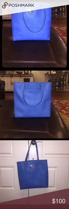 "Blue leather Michael Kors purse Very gently used blue leather Michael Kors purse. I often carried my laptop in here and it was the perfect size. There are no tears, rips, or stains. Measurements: 14"" X 3 1/2"" X 14"" Strap Drop: 9 1/2"". Michael Kors Bags Totes"