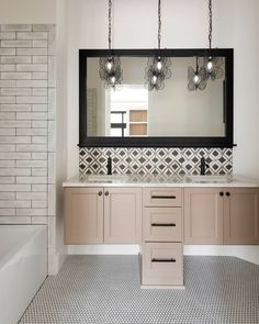 Patterned tile and butterfly pendants offer a touch of whimsy, while subway tile and a neutral color scheme bring classic elements. This kids bath by @kellifontanadesigns does it all! Build by @westbayhomes. Photo by @spacecrafting_photography.  Tiles featured: Splendours White, @annieselke Shadow Black, + Penny Round Gloss White. Bathroom Tile Designs, Bathroom Trends, The Tile Shop, Neutral Color Scheme, Kids Bath, Butterfly Pendant, Bath Remodel, Subway Tile, Tile Patterns